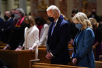 President-elect Joe Biden and his wife Jill Biden as they attend Mass at the Cathedral of St. Matthew the Apostle during Inauguration Day ceremonies Wednesday, Jan. 20, 2021, in Washington. (AP Photo/Evan Vucci)