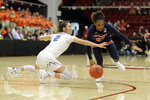 BYU guard Shaylee Gonzales, left, and Auburn guard Crystal Primm dive for a loose ball during the first half of a first-round game in the NCAA women's college basketball tournament in Stanford, Calif., Saturday, March 23, 2019. (AP Photo/Chris Carlson)
