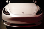 Tesla's Model Y is displayed at the company's design studio Thursday, March 14, 2019, in Hawthorne, Calif. The Model Y may be Tesla's most important product yet as it attempts to expand into the mainstream and generate enough cash to repay massive debts that threaten to topple the Palo Alto, California, company. (AP Photo/Jae C. Hong)
