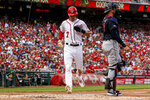 Washington Nationals' Trea Turner scores on a double by Washington Nationals' Juan Soto during the first inning of a baseball game against the Cleveland Indians at Nationals Park, Sunday, Sept. 29, 2019, in Washington. (AP Photo/Andrew Harnik)