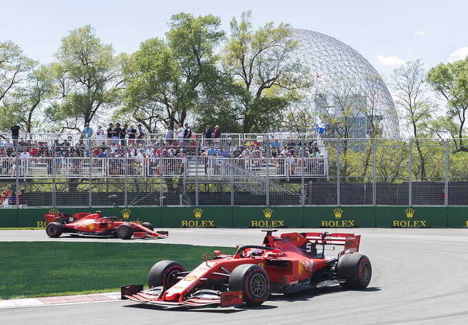 Ferrari drivers Charles Leclerc of Monaco, left, and Sebastian Vettel of Germany drive through the hairpin during the second practice session at the Formula One Canadian Grand Prix auto race, Friday, June 7, 2019,  in Montreal. (Graham Hughes/The Canadian Press via AP)