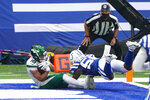 New York Jets wide receiver Braxton Berrios (10) catches a pass for a touchdown in front of Indianapolis Colts inside linebacker Bobby Okereke (58) the first half of an NFL football game in Indianapolis, Sunday, Sept. 27, 2020. (AP Photo/AJ Mast)