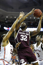 Auburn center Austin Wiley (50) defends a shot by Texas A&M forward Josh Nebo (32) during the first half of an NCAA college basketball game Wednesday, March 4, 2020, in Auburn, Ala. (AP Photo/Julie Bennett)