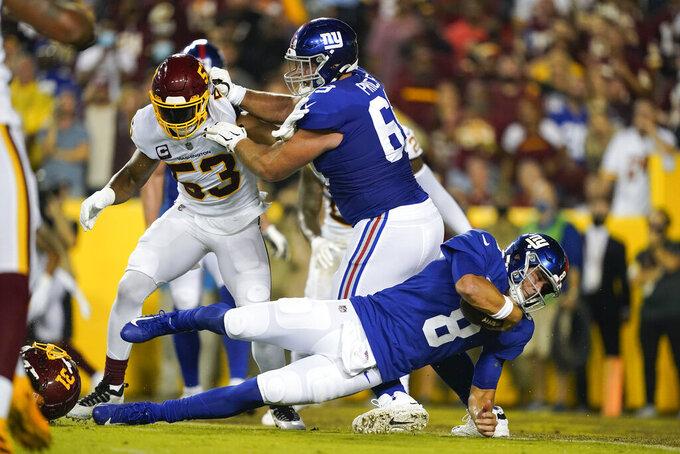 New York Giants quarterback Daniel Jones (8) scores a touchdown against the Washington Football Team during the first half of an NFL football game, Thursday, Sept. 16, 2021, in Landover, Md. (AP Photo/Al Drago)