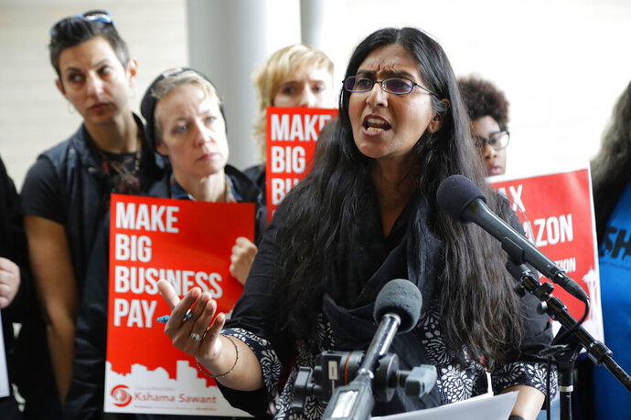 FILE - In this June 12, 2018, file photo, Seattle City Council member Kshama Sawant speaks at City Hall in Seattle. Seattle's elections watchdog has charged Sawant with violating the law by using her office to promote a potential ballot measure that would tax Amazon and other large companies to pay for things like affordable housing. The Seattle Times reports the charges against Sawant were filed Monday, Feb. 10, 2020. (AP Photo/Ted S. Warren, File)