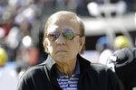 FILE - In this Oct. 12, 2016, file photo, former Oakland Raiders head coach Tom Flores looks on before an NFL football game between the Raiders and the San Diego Chargers in Oakland, Calif. The AFL gave Flores one last chance when the fledging league launched in 1960 and Flores seized the opportunity. He became the original quarterback of the Raiders before going on to a trailblazing career as a coach and executive that landed him in the Pro Football Hall of Fame following a lengthy wait. (AP Photo/Marcio Jose Sanchez, File)