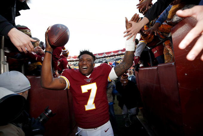 Washington Redskins quarterback Dwayne Haskins runs off the field after an NFL football game against the Detroit Lions, Sunday, Nov. 24, 2019, in Landover, Md. The Redskins won 19-16. (AP Photo/Alex Brandon)