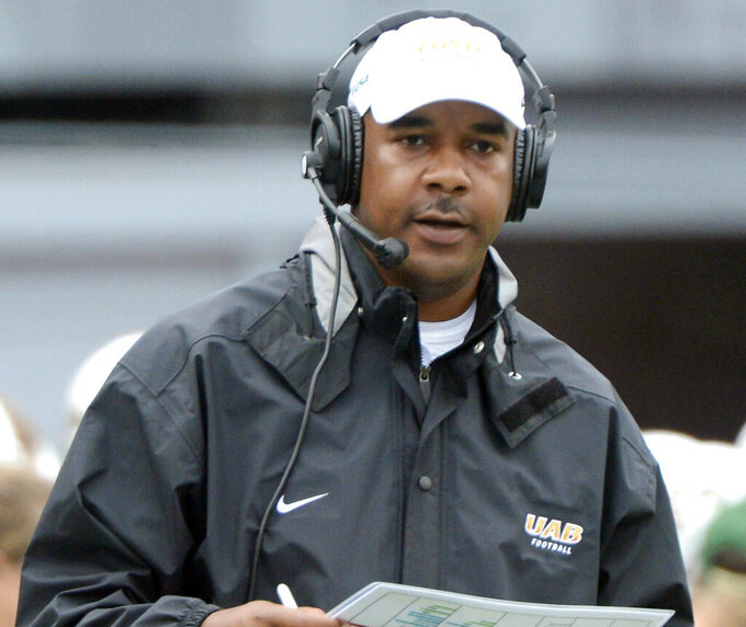 FILE - In this Sept. 21, 2013, file photo, UAB coach Garrick McGee watches the second quarter of an NCAA college football game against Northwestern State at Legion Field in Birmingham, Ala. Florida promoted McGee from analyst to quarterbacks coach Friday, Jan. 29, 2021, filling a vacancy created by Brian Johnson's departure to the NFL's Philadelphia Eagles. McGee spent the 2020 season working behind the scenes at Florida after a two-year stint at Missouri. The former Alabama-Birmingham head coach has bounced from job to job for most of the past decade. (Mark Almond/The Birmingham News via AP, File)