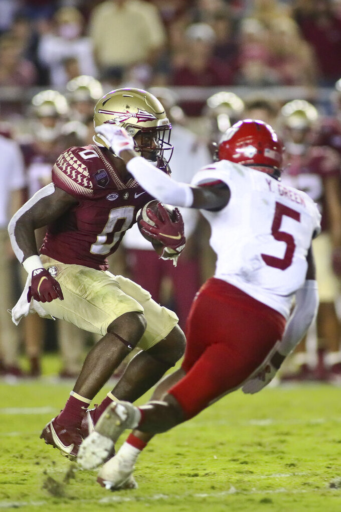 Florida State running back Jashaun Corbin (0) sets up the second touchdown as he runs by Jacksonville State cornerback Yessman Green (5) late in the second quarter of an NCAA college football game Saturday, Sept. 11, 2021, in Tallahassee, Fla. (AP Photo/Phil Sears)
