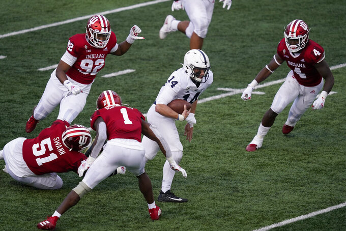 Penn State's Sean Clifford 914) runs out of a tackle by Indiana's Jovan Swann (51) for a touchdown during the second half of an NCAA college football game, Saturday, Oct. 24, 2020, in Bloomington, Ind. (AP Photo/Darron Cummings)