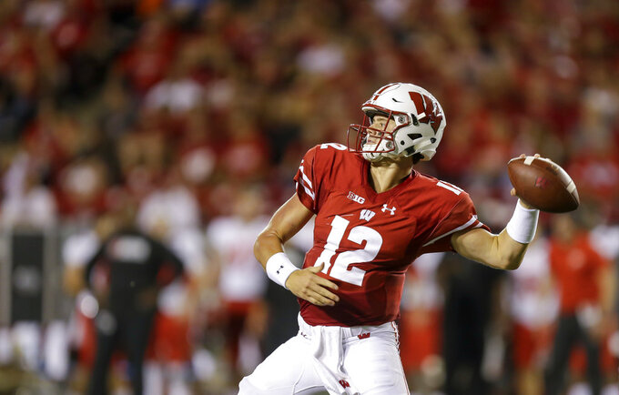 Wisconsin quarterback Alex Hornibrook throws a pass against Western Kentucky during the first half of an NCAA college football game Friday, Aug. 31, 2018, in Madison, Wis. (AP Photo/Andy Manis)
