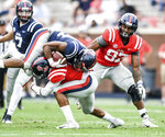 Mississippi running back Snoop Conner (24) is tackled by Jon Haynes (5) during the Grove Bowl spring NCAA college football game at Vaught-Hemingway Stadium in Oxford, Miss., Saturday, April 6, 2019. (Bruce Newman/The Oxford Eagle via AP)