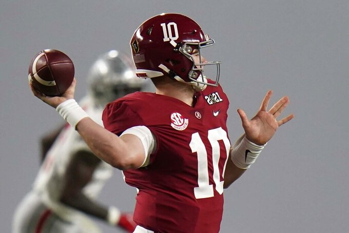 Alabama quarterback Mac Jones passes against Ohio State during the first half of an NCAA College Football Playoff national championship game, Monday, Jan. 11, 2021, in Miami Gardens, Fla. (AP Photo/Chris O'Meara)
