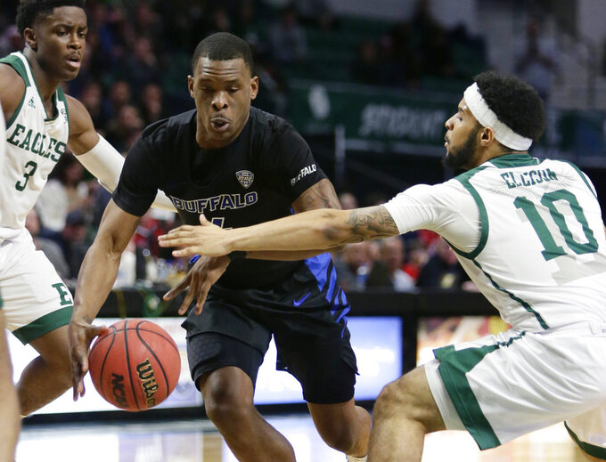 Buffalo guard Davonta Jordan (4) drives to the basket against Eastern Michigan guard Malik Ellison (10) during the first half of an NCAA college basketball game Friday, Jan. 4, 2019, in Ypsilanti, Mich. (AP Photo/Duane Burleson)