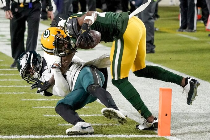Green Bay Packers' Davante Adams catches a touchdown pass with Philadelphia Eagles' Darius Slay defending during the second half of an NFL football game Sunday, Dec. 6, 2020, in Green Bay, Wis. (AP Photo/Morry Gash)
