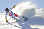 Switzerland's Gino Caviezel speeds down the course during an alpine ski, men's World Cup giant slalom in Soelden, Austria, Sunday, Oct. 18, 2020. (AP Photo/Giovanni Auletta)