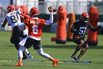 Cleveland Browns quarterback Baker Mayfield (6) throws a pass during an NFL football practice in Berea, Ohio, Tuesday, Aug. 24, 2021. (AP Photo/David Dermer)