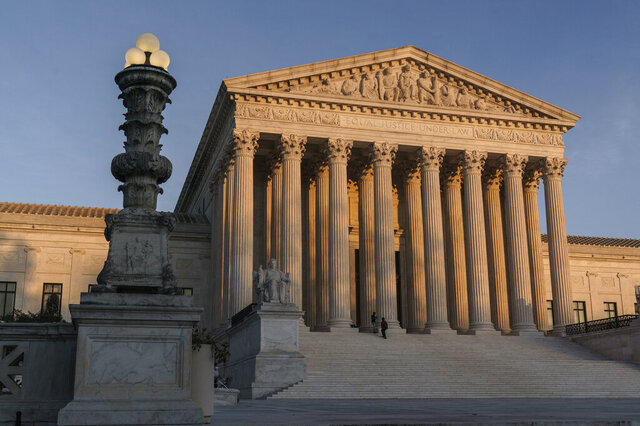 FILE - In this Nov. 6, 2020, file photo the Supreme Court is seen as sundown in Washington. The Supreme Court is telling a lower court to continue to consider a case brought by a Texas death row inmate protesting a policy that means a chaplain can't accompany him into the death chamber. The justices on Monday ordered Ruben Gutierrez's case sent back to a federal trial-level court. (AP Photo/J. Scott Applewhite, File)