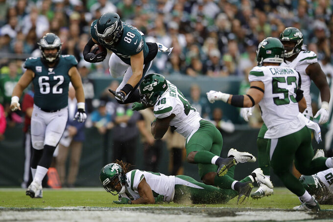 Philadelphia Eagles' Dallas Goedert (88) tries to avoid a tackle from New York Jets' Neville Hewitt (46) during the first half of an NFL football game, Sunday, Oct. 6, 2019, in Philadelphia. (AP Photo/Matt Rourke)