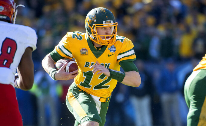 North Dakota State quarterback Easton Stick (12) runs the ball against Eastern Washington during the first half of the FCS championship NCAA college football game, Saturday, Jan. 5, 2019, in Frisco, Texas. (AP Photo/Jeffrey McWhorter)