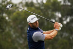 Dustin Johnson watches his tee shot on the fourth hole during the final round of the PGA Championship golf tournament at TPC Harding Park Sunday, Aug. 9, 2020, in San Francisco. (AP Photo/Jeff Chiu)