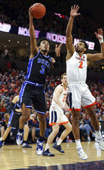 Duke guard Tre Jones (3) shoots as Virginia guard Braxton Key (2) defends during an NCAA college basketball game Saturday, Feb. 29, 2020, in Charlottesville, Va. (AP Photo/Andrew Shurtleff)