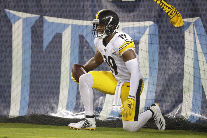 Pittsburgh Steelers wide receiver JuJu Smith-Schuster gets up after catching a 17-yard touchdown pass against the Tennessee Titans in the first half of a preseason NFL football game Sunday, Aug. 25, 2019, in Nashville, Tenn. (AP Photo/James Kenney)