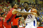Dayton forward Obi Toppin (1) knocks the ball away from Kansas center Udoka Azubuike (35) during the first half of an NCAA college basketball game Wednesday, Nov. 27, 2019, in Lahaina, Hawaii. (AP Photo/Marco Garcia)