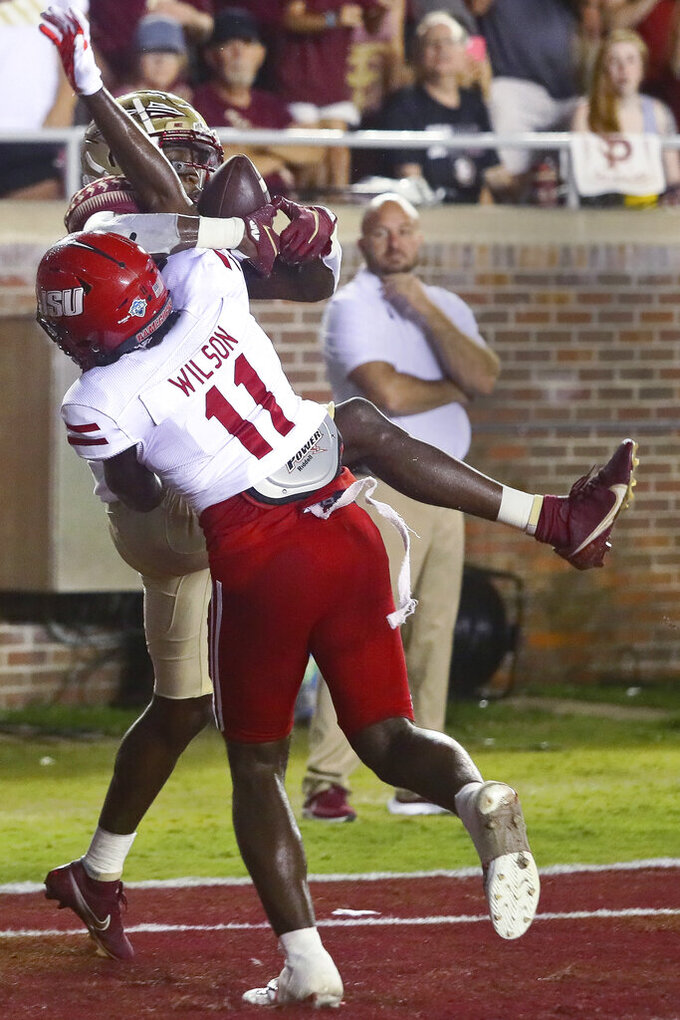 Florida State wide receiver Malik McClain, back, can't secure a touchdown pass as Jacksonville State safety Deco Wilson (11) defends during the fourth quarter of an NCAA college football game Saturday, Sept. 11, 2021, in Tallahassee, Fla. Jacksonville State won 20-17. (AP Photo/Phil Sears)
