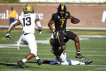 Missouri running back Tyler Badie (1) runs with the ball as Vanderbilt safety Brendon Harris (13) and cornerback Elijah Hamilton defend during the first half of an NCAA college football game Saturday, Nov. 28, 2020, in Columbia, Mo. (AP Photo/L.G. Patterson)