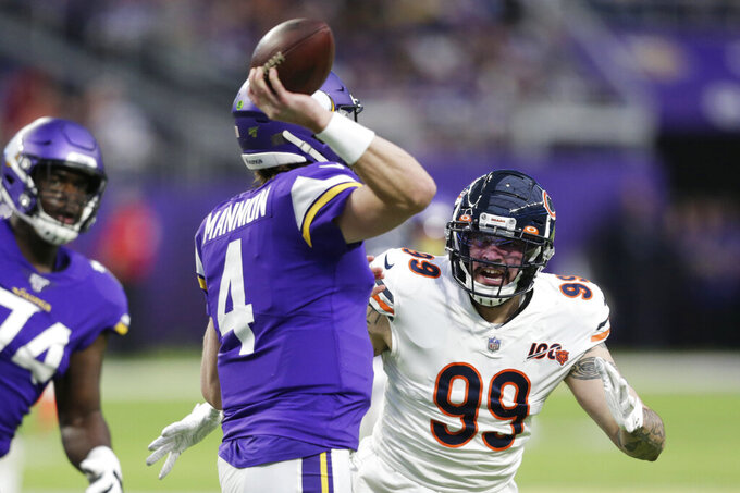 FILE - In this Dec. 29, 2019, file photo, Chicago Bears outside linebacker Aaron Lynch (99) pressures Minnesota Vikings quarterback Sean Mannion (4) during the second half of an NFL football game in Minneapolis. Veteran pass rusher Aaron Lynch signed a one-year contract with Jacksonville on Tuesday, May 5, 2020, giving the Jaguars more depth in case disgruntled defender Yannick Ngakoue decides to skip part of the season.(AP Photo/Andy Clayton-King, File)