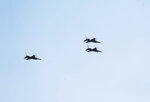 In honor of Ross Perot's commitment to the military and veterans, F-16 fighter jets fly during his gravesite service in a missing man formation over Sparkman-Hillcrest Memorial Park Cemetery in Dallas on Tuesday, July 16, 2019. The U.S. Air Force conducted the F-16 flyover in the missing man formation for the graveside service of the colorful Texas billionaire. (Vernon Bryant/The Dallas Morning News via AP)