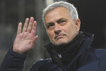FILE - In this Thursday, March 4, 2021 file photo, Tottenham's manager Jose Mourinho waves during the English Premier League soccer match between Fulham v Tottenham Hotspur at the Craven Cottage stadium in London.  A person with knowledge of the situation says Tottenham has fired manger Jose Mourinho. The person spoke on condition of anonymity because the decision has not yet been made public by Tottenham. Mourinho took over in November 2019. His firing comes with seventh-place Tottenham outside the Champions League places but with a League Cup final against Manchester City on Sunday, April 18, 2021.  (Neil Hall/Pool via AP, File)