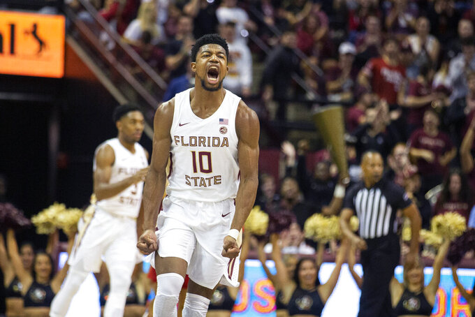 Florida State forward Malik Osborne (10) reacts after hitting a three-point basket against Louisville in the first half of an NCAA college basketball game in Tallahassee, Fla., Monday, Feb. 24, 2020. (AP Photo/Mark Wallheiser)