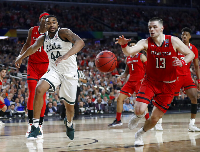 Texas Tech's Matt Mooney (13) chases a loose ball against Michigan State's Nick Ward (44) during the second half in the semifinals of the Final Four NCAA college basketball tournament, Saturday, April 6, 2019, in Minneapolis. (AP Photo/Jeff Roberson)