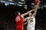 Ohio State forward Kyle Young, left, and Iowa forward Ryan Kriener, right, battle for a rebound during the first half of an NCAA college basketball game, Saturday, Jan. 12, 2019, in Iowa City, Iowa. (AP Photo/Matthew Putney)