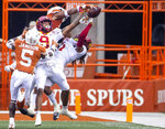 Texas defensive back Josh Thompson, top, swats the ball out of Iowa State wide receiver Tarique Milton (1) hands in the end zone late during the second quarter of an NCAA college football game on Saturday, Nov. 27, 2020, in Austin, Texas. (Ricardo B. Brazziell/Austin American-Statesman via AP)