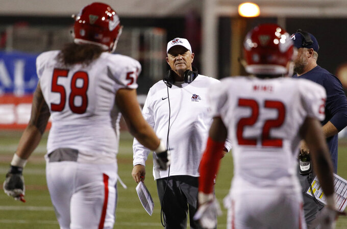Fresno State Bulldogs head coach Jeff Tedford looks at players after a play against the UNLV Rebels during the second half of an NCAA college football game Saturday, Nov. 3, 2018, in Las Vegas. (AP Photo/John Locher)