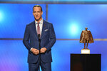 "FILE - In this Feb. 2, 2019, file photo, former NFL player Peyton Manning presents the Walter Payton NFL man of the year award at the 8th Annual NFL Honors at The Fox Theatre in Atlanta. Just as he had the true touch when he threw passes, set records and won two Super Bowls on the field, Peyton Manning possesses the right approach to look back at some of the NFL's greatest moments. Manning, a lock for the Pro Football Hall of Fame when he becomes eligible in 2021, is hosting and serves as one of the executive producers for ""Peyton's Places,"" a five-part, 30-episode series that celebrates the NFL's 100th season. (Photo by Paul Abell/Invision for NFL/AP Images, File)"