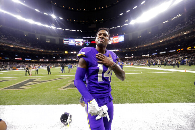 Minnesota Vikings wide receiver Stefon Diggs (14) reacts overtime of an NFL wild-card playoff football game against the New Orleans Saints, Sunday, Jan. 5, 2020, in New Orleans. The Vikings won 26-20. (AP Photo/Brett Duke)