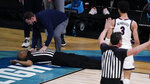 Referee Bert Smith collapses on the court during the first half of an Elite 8 game between Gonzaga and Southern California during the first half of an Elite 8 game in the NCAA men's college basketball tournament at Lucas Oil Stadium, Tuesday, March 30, 2021, in Indianapolis. (AP Photo/Michael Conroy)