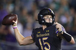 Northwestern quarterback Hunter Johnson throws against Michigan State during the first half of an NCAA college football game in Evanston, Ill., Friday, Sept. 3, 2021. (AP Photo/Nam Y. Huh)