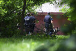 Milwaukee Police officers search a lot in Milwaukee in the 1600 north block of 26th Street Saturday, July 13, 2019 as part of an active investigation into the fatal shooting of a three-year-old girl during a road rage incident Saturday morning. (Colin Boyle/Milwaukee Journal-Sentinel via AP)