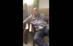 In this image made from video on Sunday, Sept. 5, 2021, Guinean President Alpha Conde sits on a sofa in an unknown location. Footage posted on social media showed Guinea's president Alpha Conde in a room and sat next to a soldier on Sunday, as a Guinean army colonel seized control of state television and declared that Conde's government had been dissolved. It was not immediately clear at what stage the video was taken. (UGC via AP)