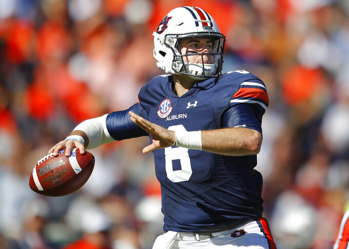 FILE - In this Saturday, Nov. 3, 2018 file photo, Auburn quarterback Jarrett Stidham (8) drops back to pass against Texas A&M during the first half of an NCAA college football game in Auburn, Ala. Things haven't gone the way Auburn hoped this season. Going from the top 10 to unranked leaves the Tigers only one way to appease restless fans: Play the spoiler and upset their biggest rival, No. 1 Alabama. (AP Photo/Todd Kirkland, File)