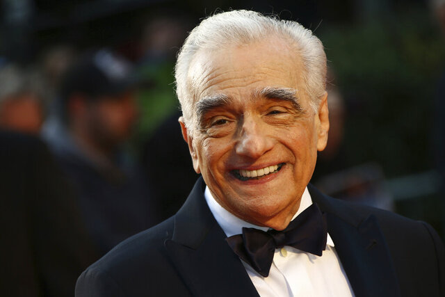 FILE - In this Sunday, Oct. 13, 2019, file photo, director Martin Scorsese poses for photographers upon arrival at the premiere of the film