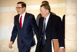 U.S. Treasury Secretary Steven Mnuchin, left, and U.S. Trade Representative Robert Lighthizer walk together as they leave their hotel in Beijing, Friday, Feb. 15, 2019. U.S. and Chinese negotiators opened talks Thursday on a sprawling trade dispute as Beijing reported its January exports rebounded despite President Donald Trump's tariff hikes. (AP Photo/Mark Schiefelbein)