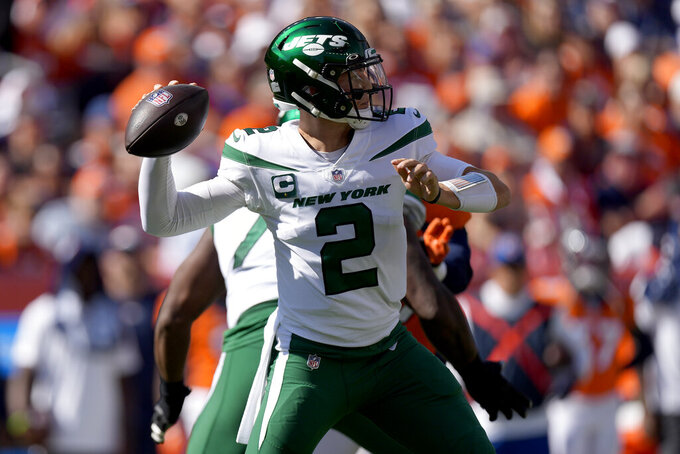 New York Jets quarterback Zach Wilson (2) throws against the Denver Broncos during the first half of an NFL football game, Sunday, Sept. 26, 2021, in Denver. (AP Photo/David Zalubowski)