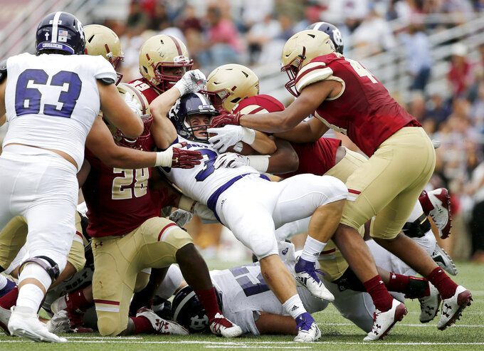 Boston College defenders stop the rush from Holy Cross running back Peter Oliver (36) during the second half of a college football game, Saturday, Sept. 8, 2018, in Boston. (AP Photo/Mary Schwalm)