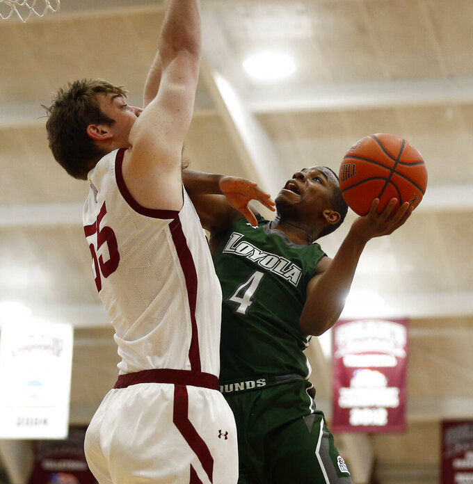 Loyola (Md.) Isaiah Hart (4) goes up for a shot over Colgate's Jeff Woodward (55) during an NCAA college basketball game in the finals of the Patriot League tournament, Sunday, March 14, 2021, in Hamilton, N.Y. (AP Photo/John Munson)